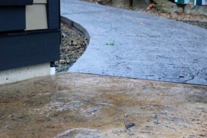 Stamped Concrete resurfacing and sealing of Patio Flooring by Top Seal